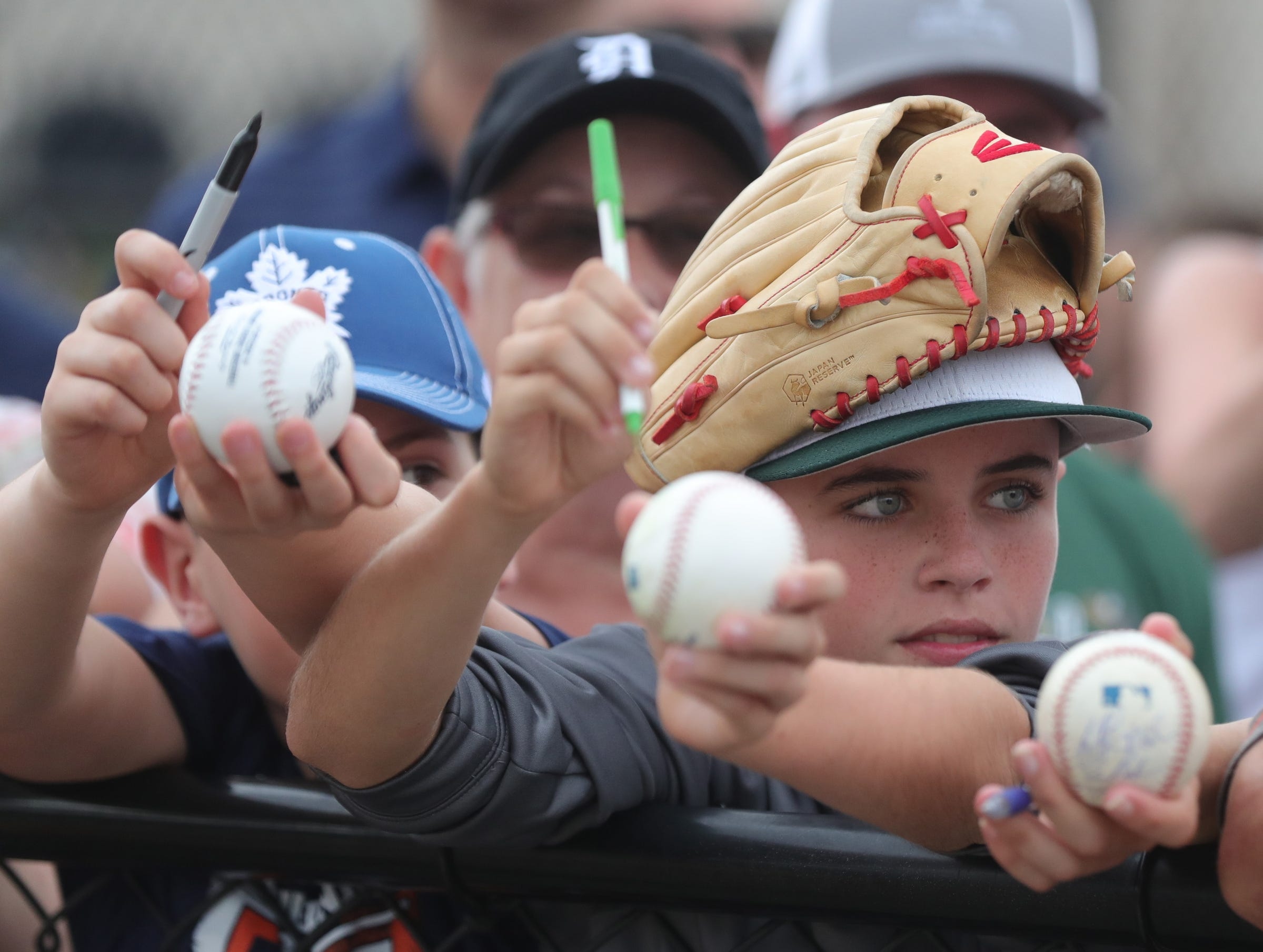 Tigers fan Deaglan McBride waits for autographs during the first full team spring training practice on Monday, Feb. 18, 2019, at Joker Marchant Stadium in Lakeland, Florida.