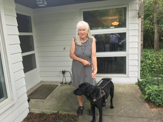 """Geraldine """"Geri"""" Taeckens, a blind woman who served two years at Women's Huron Valley Correctional Facility, shown with her guide dog Fiona after her 2018 release. Taeckens did not try to arrange to bring Fiona to prison and said she later determined the prison would have been too confining for her dog."""