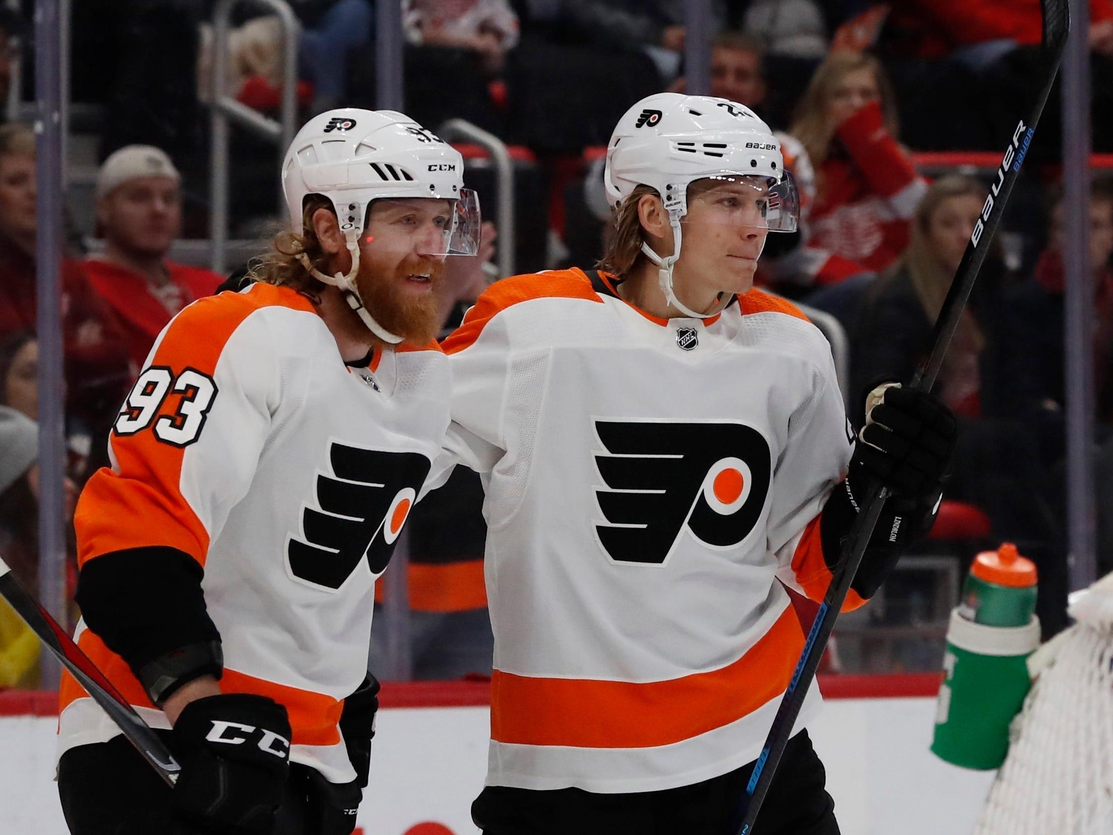 Philadelphia Flyers right wing Jakub Voracek (93) congratulates teammate  Oskar Lindblom after Lindblom's goal during the first period on Feb. 17, 2019, in Detroit.