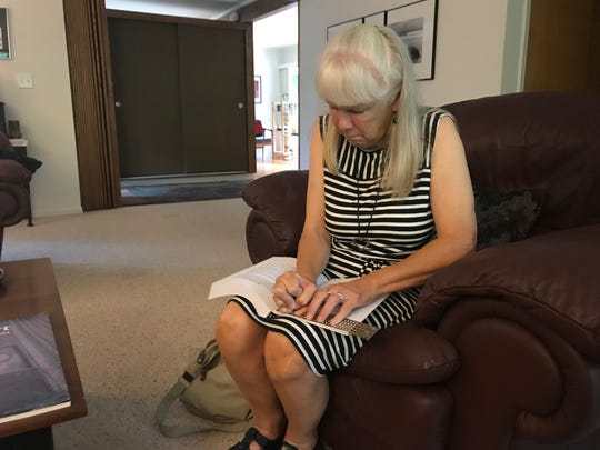 Geri Taeckens, a blind woman who served two years in state prison, uses a slate and stylus to write Braille.