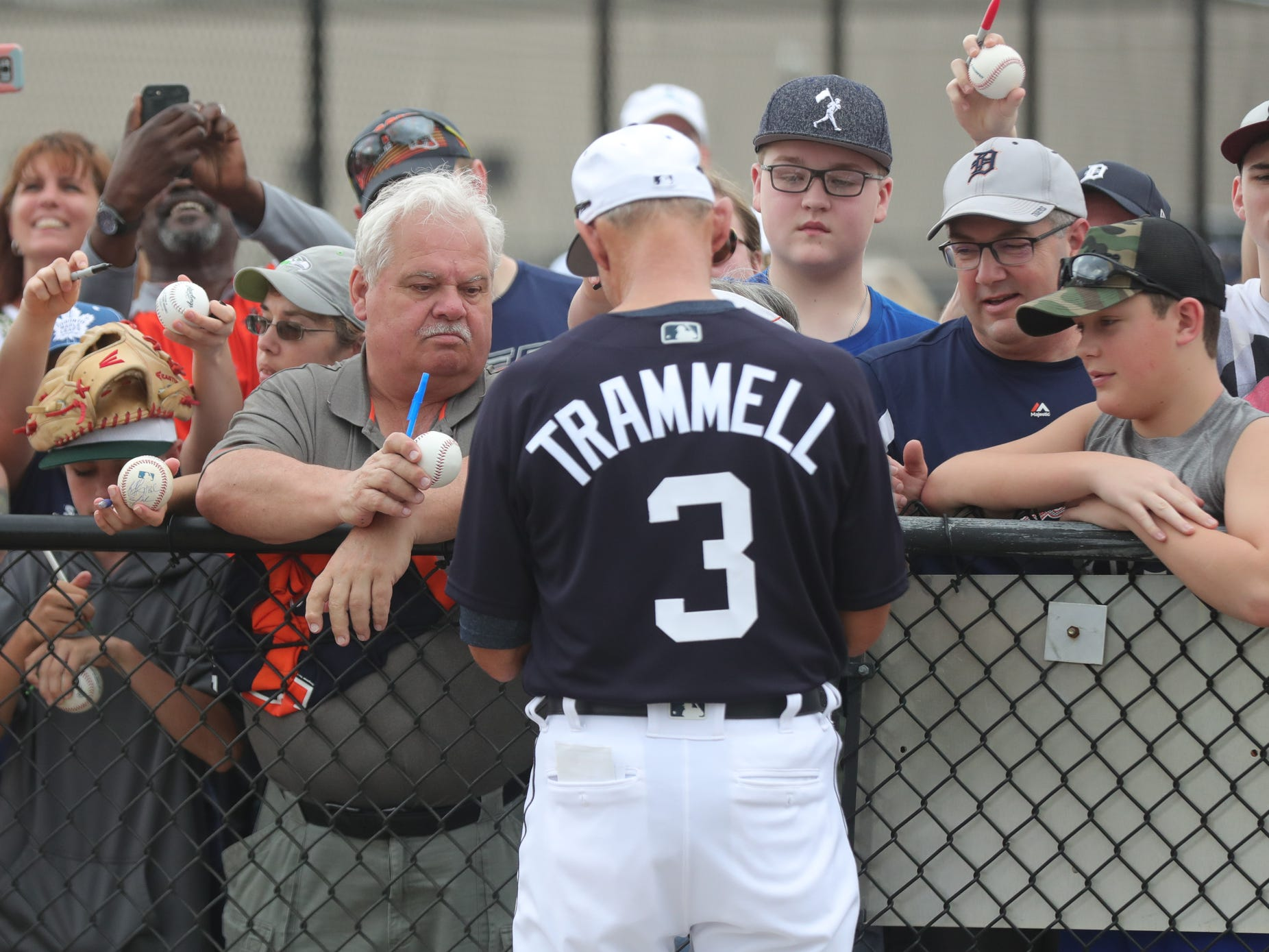 Tigers Hall of Famer Alan Trammell signs autographs for fans during the first full team spring training practice on Monday, Feb. 18, 2019, at Joker Marchant Stadium in Lakeland, Florida.