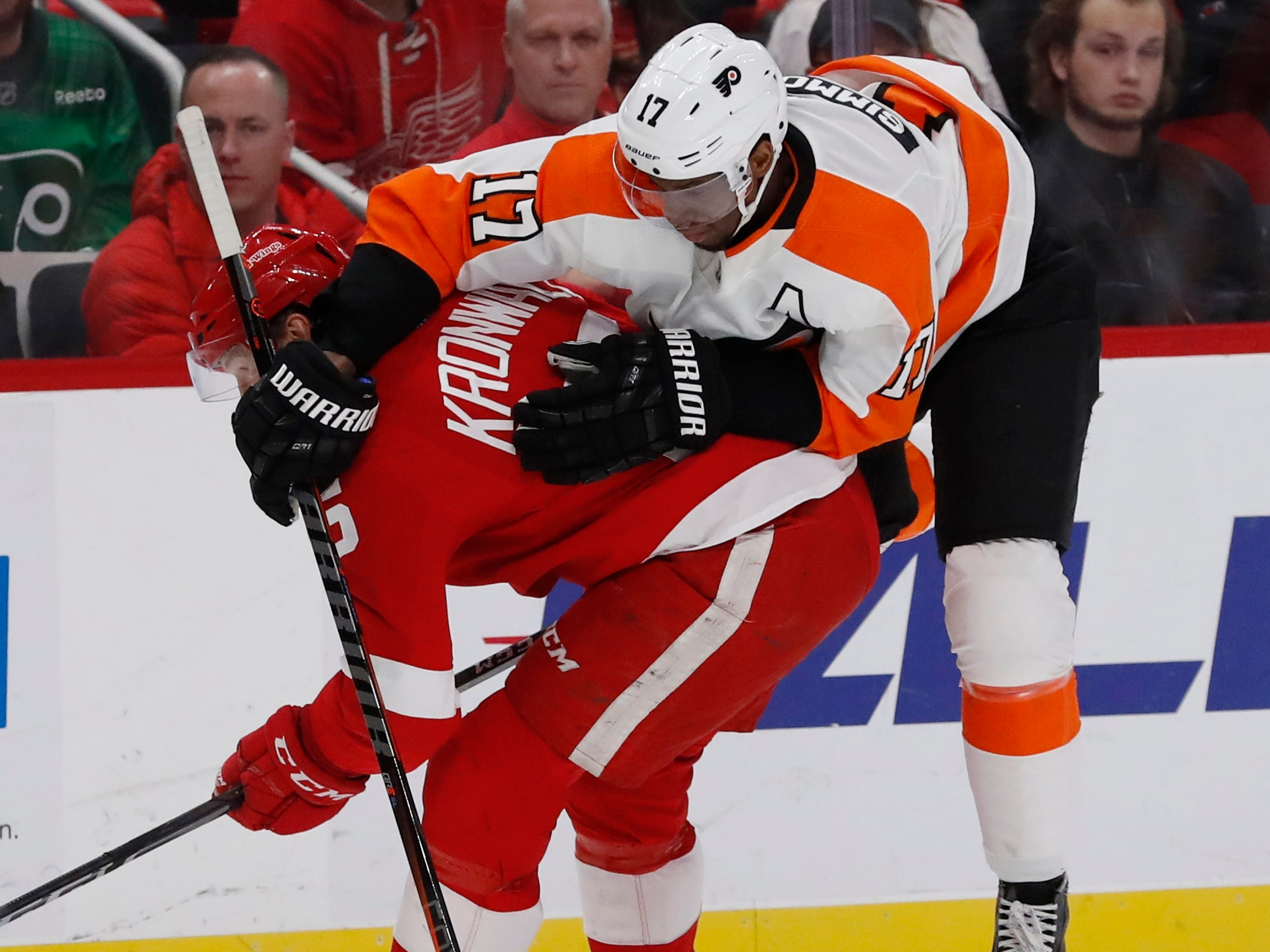 Flyers right wing Wayne Simmonds (17) runs into Red Wings defenseman Niklas Kronwall (55) during the first period on Feb. 17, 2019, in Detroit.