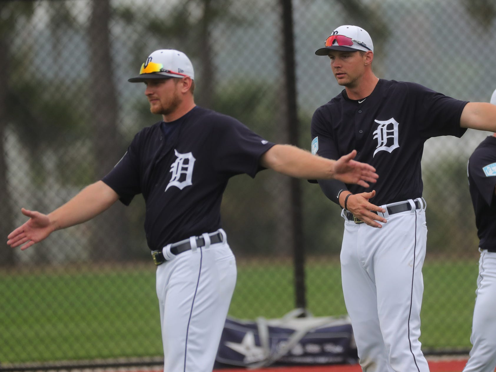 Tigers catchers John Hicks, left, and Grayson Greiner stretch during the first full team spring training practice on Monday, Feb. 18, 2019, at Joker Marchant Stadium in Lakeland, Florida.