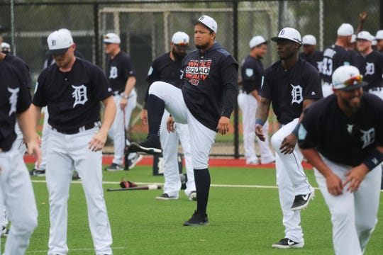 Miguel Cabrera stretches Monday during the first full-team workout.
