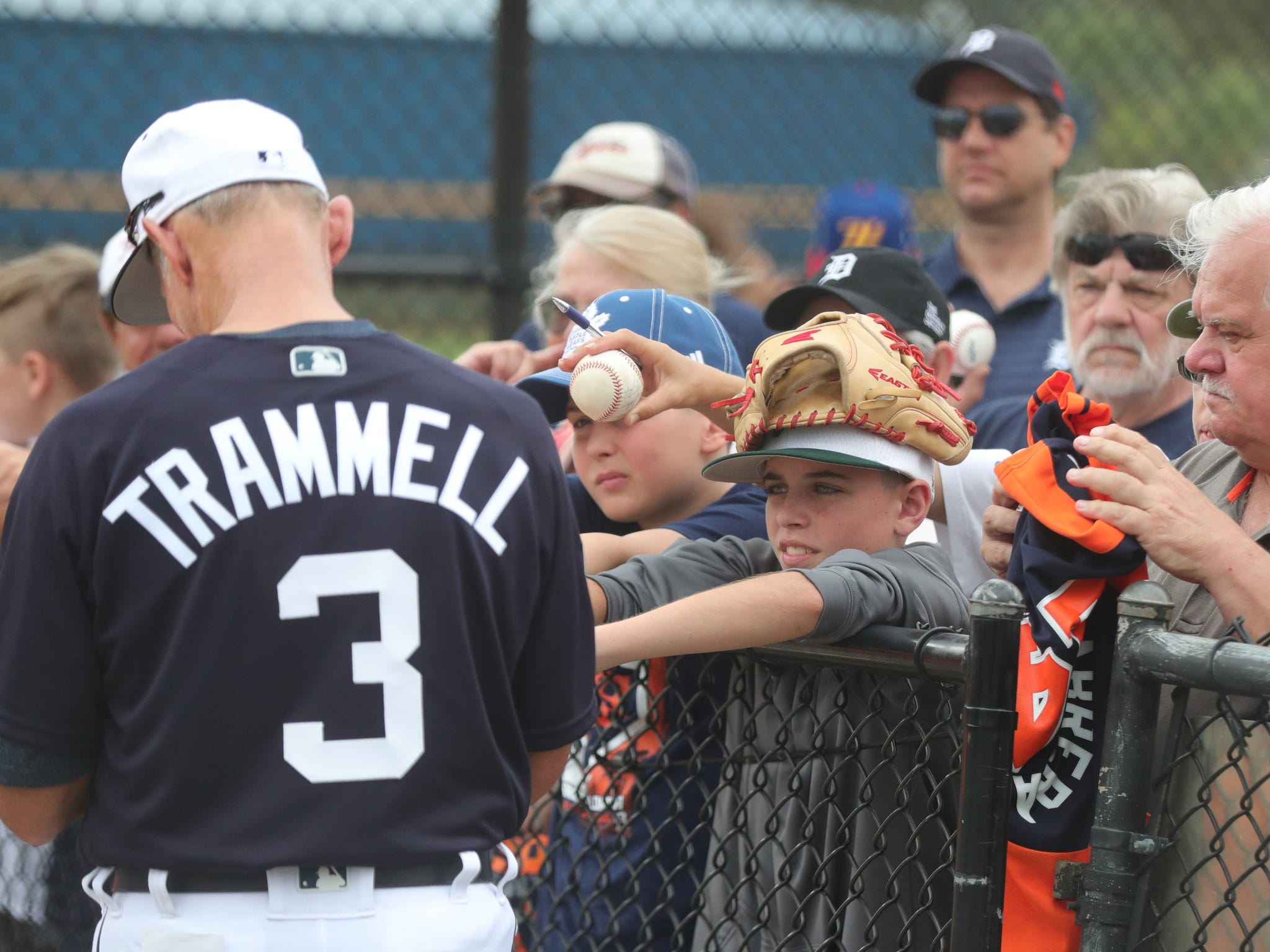 Tigers Hall of Famer Alan Trammell signs autographs before the first full team spring training practice on Monday, Feb. 18, 2019, at Joker Marchant Stadium in Lakeland, Florida.