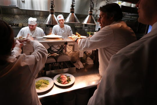 Bacco Ristorante owner Luciano Del Signore watches over plates being made before sending them out to patrons at his Southfield restaurant in 2013.