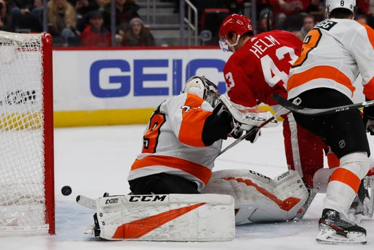 Red Wings forward Darren Helm (43) shoots the puck past Flyers goaltender Carter Hart (79) for a goal during the second period on Feb. 17, 2019, in Detroit.