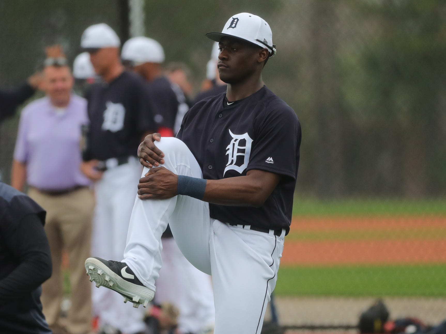 Tigers outfielder Daz Cameron stretches during the first full team spring training practice on Monday, Feb. 18, 2019, at Joker Marchant Stadium in Lakeland, Florida.