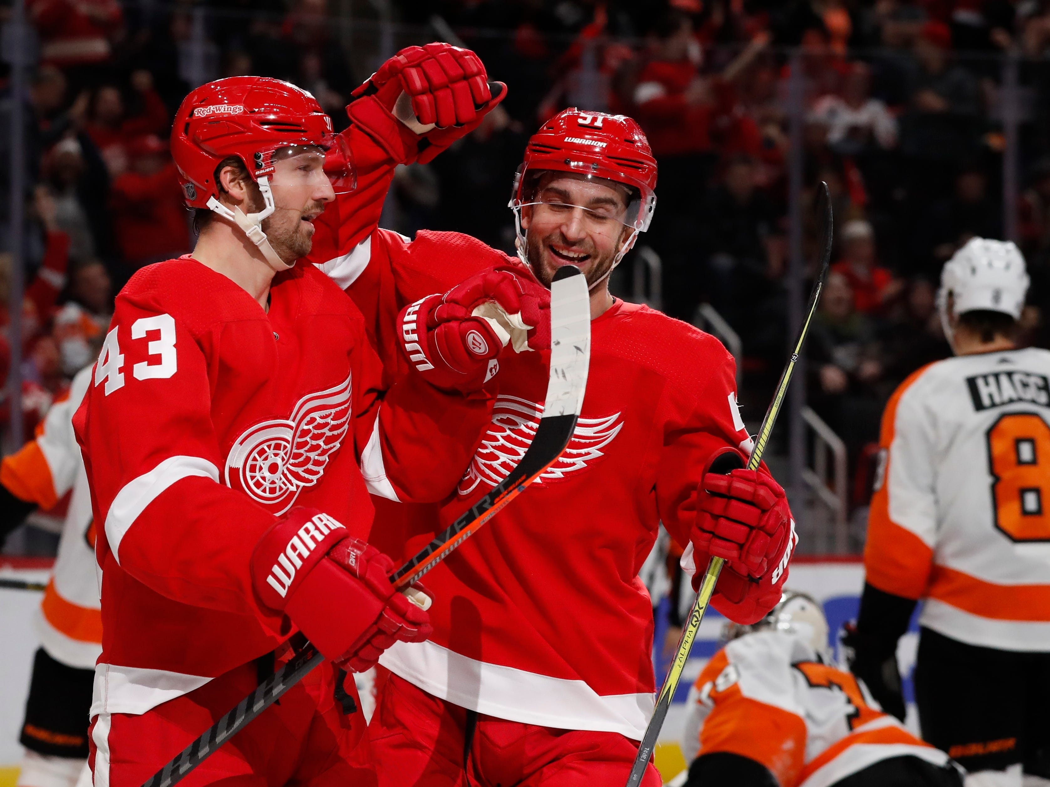 Red Wings forward Darren Helm (43) is congratulated on his goal by teammate center Frans Nielsen (51) during the second period against the Flyers on Feb. 17, 2019, in Detroit.