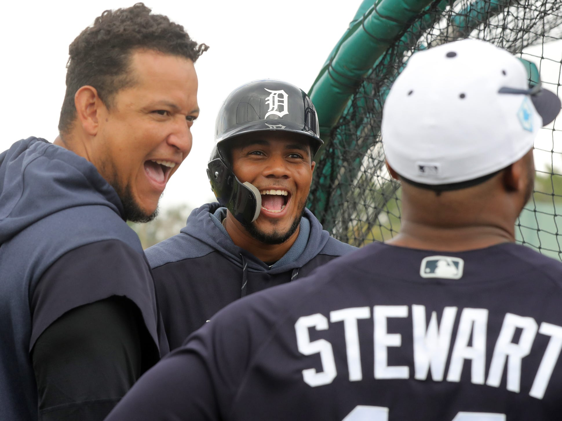 Tigers infielders Miguel Cabrera, left, and Jeimer Candelario joke with outfielder Christin Stewart during the first full team spring training practice on Monday, Feb. 18, 2019, at Joker Marchant Stadium in Lakeland, Florida.