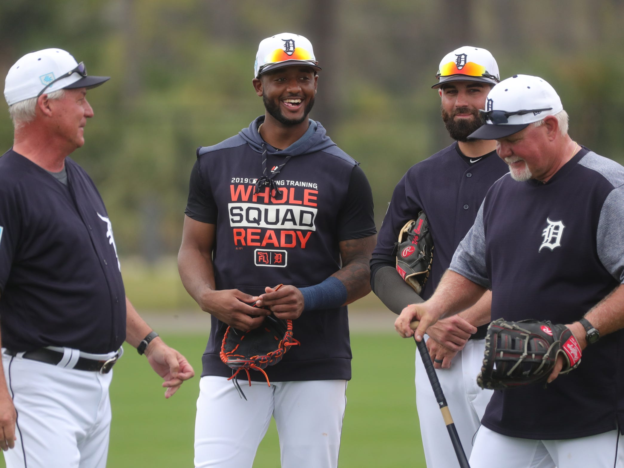 Tigers infielder Niko Goodrum (center) and manager Ron Gardenhire, right. talk during the first full team spring training practice on Monday, Feb. 18, 2019, at Joker Marchant Stadium in Lakeland, Florida.
