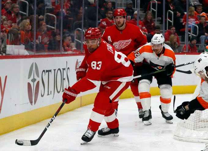 Red Wings defenseman Trevor Daley (83) controls the puck during the third period against the Philadelphia Flyers on Feb. 17, 2019, in Detroit.