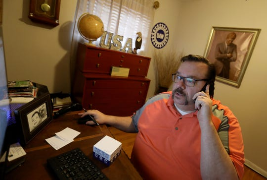 Ed Bourassa, who is the treasurer of the City of Taylor, answers a citizen's question about city taxes from his home office in Taylor, Michigan on Wednesday, February 13, 2019. Bourassa is on disability recovering from a fall last year at a hospital.  .