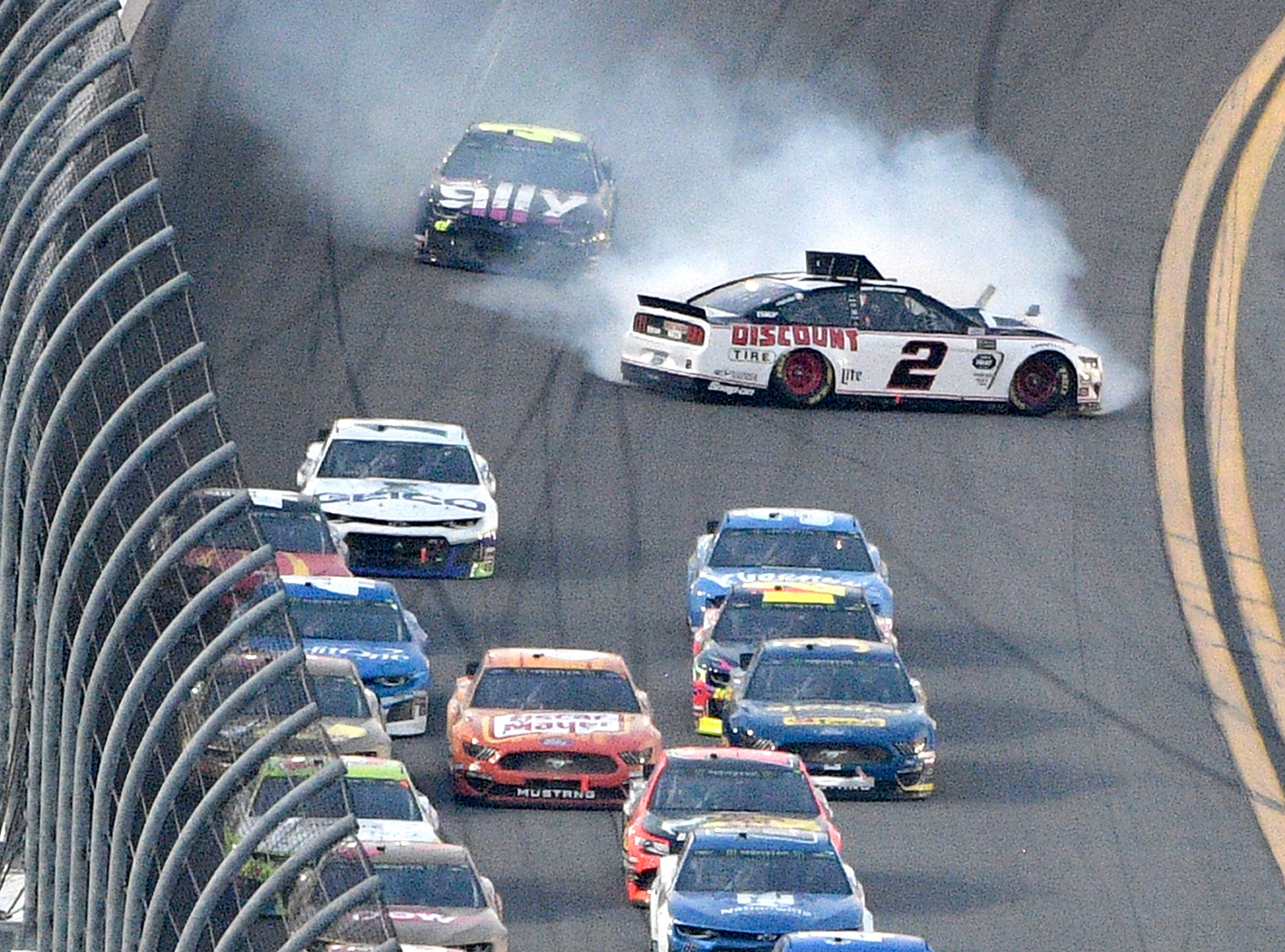 Brad Keselowski (2) spins in Turn 4 during a NASCAR Daytona 500 auto race at Daytona International Speedway.