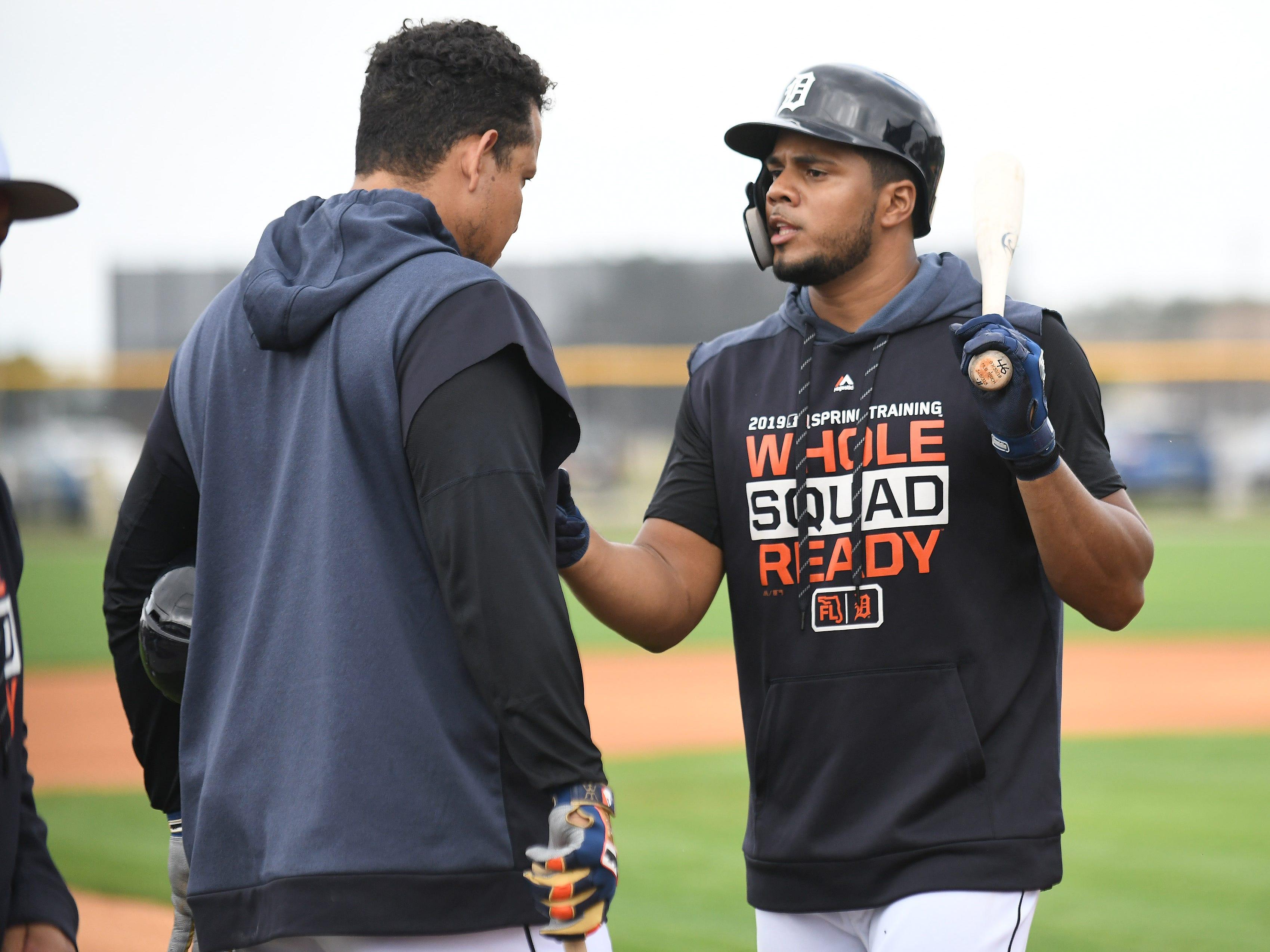 Tigers' Jeimer Candelario and Miguel Cabrera, left, talk between turns at batting practice.