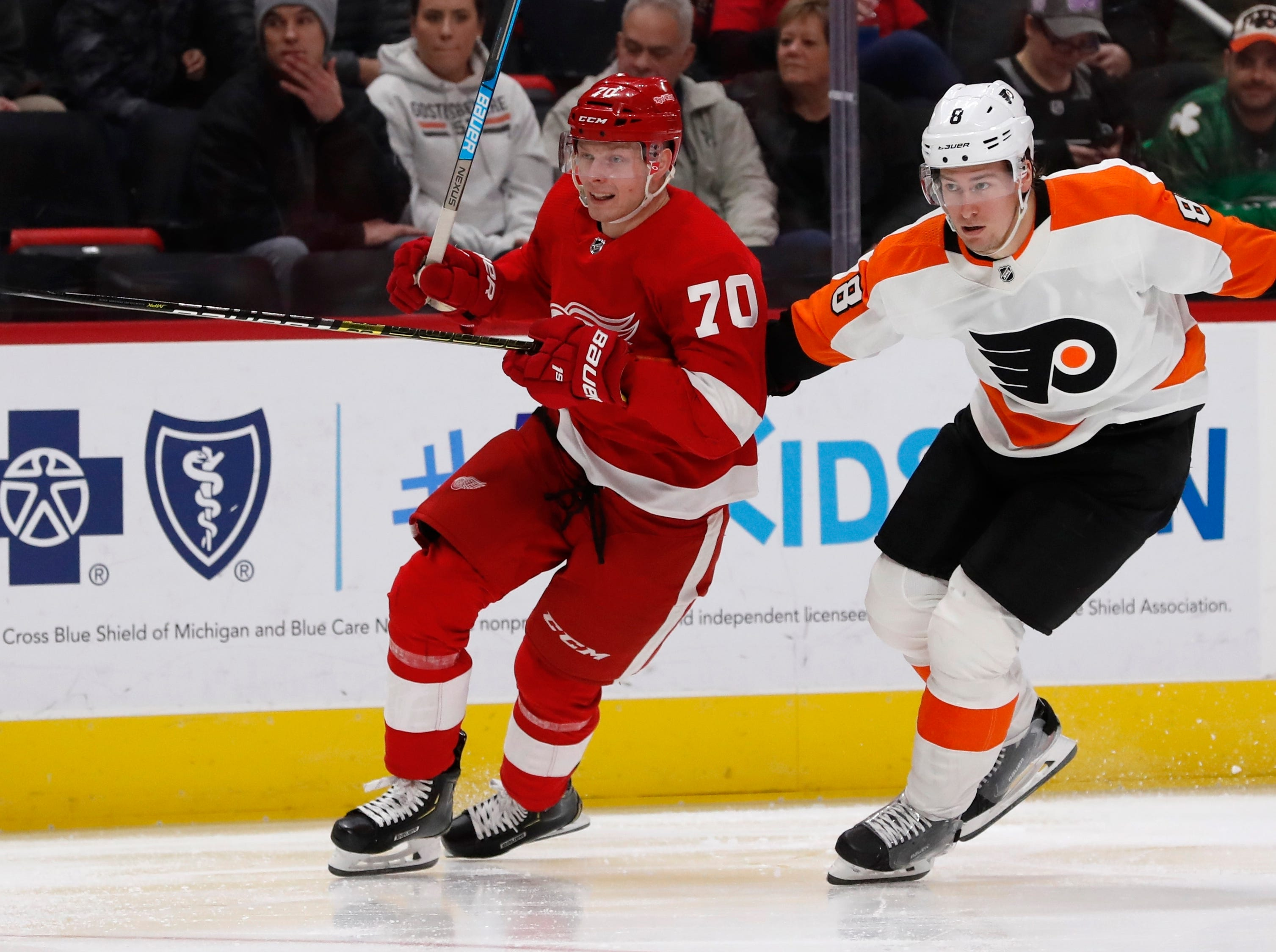 Detroit Red Wings center Christoffer Ehn (70) skates in front of Philadelphia Flyers defenseman Robert Hagg (8) during the second period.