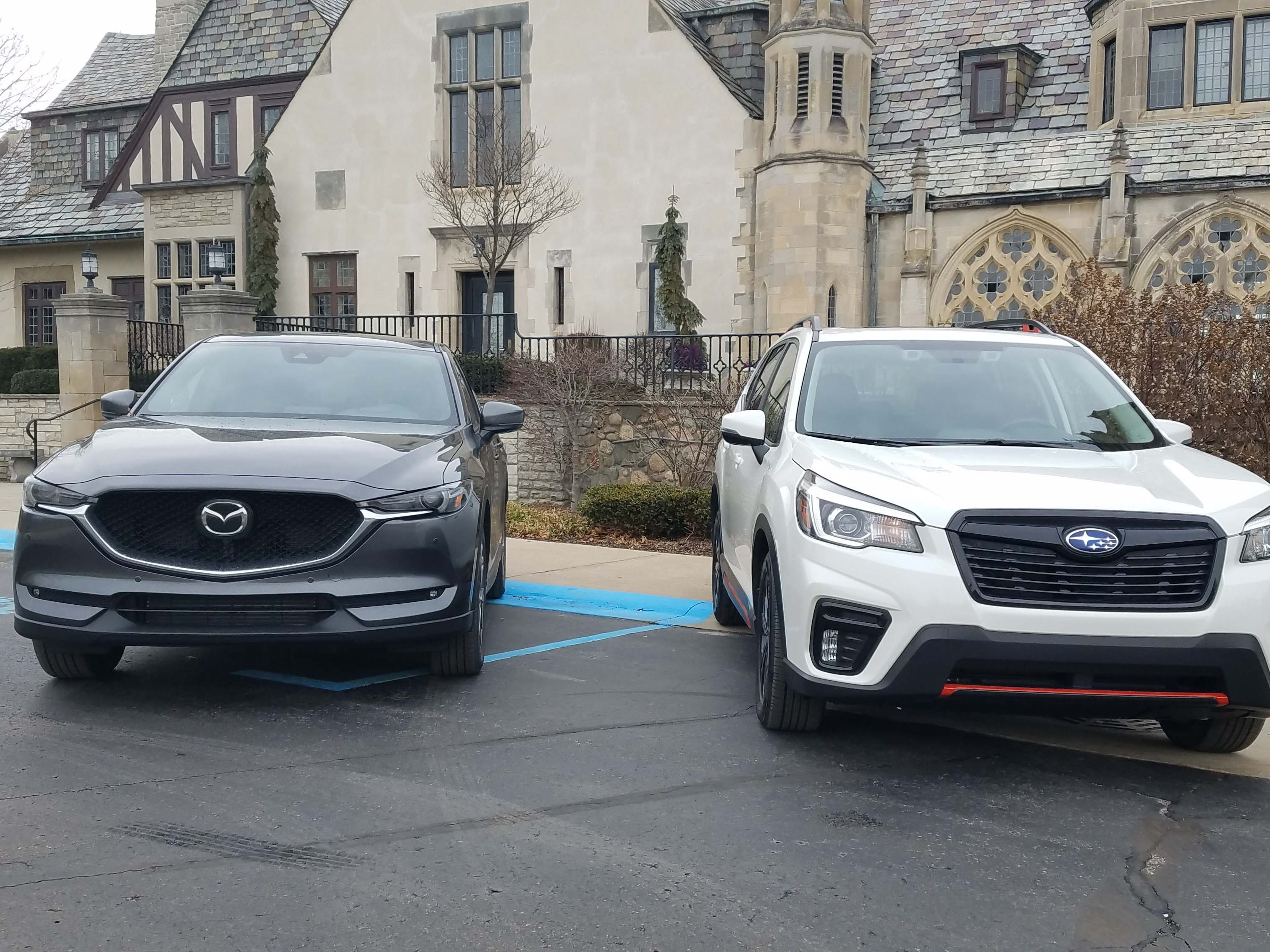 The Mazda CX-5 Signature, left, and Subaru Forester Sport show off their kissers. The Mazda is prettier than most luxury makes — but the Subaru is no wallflower.