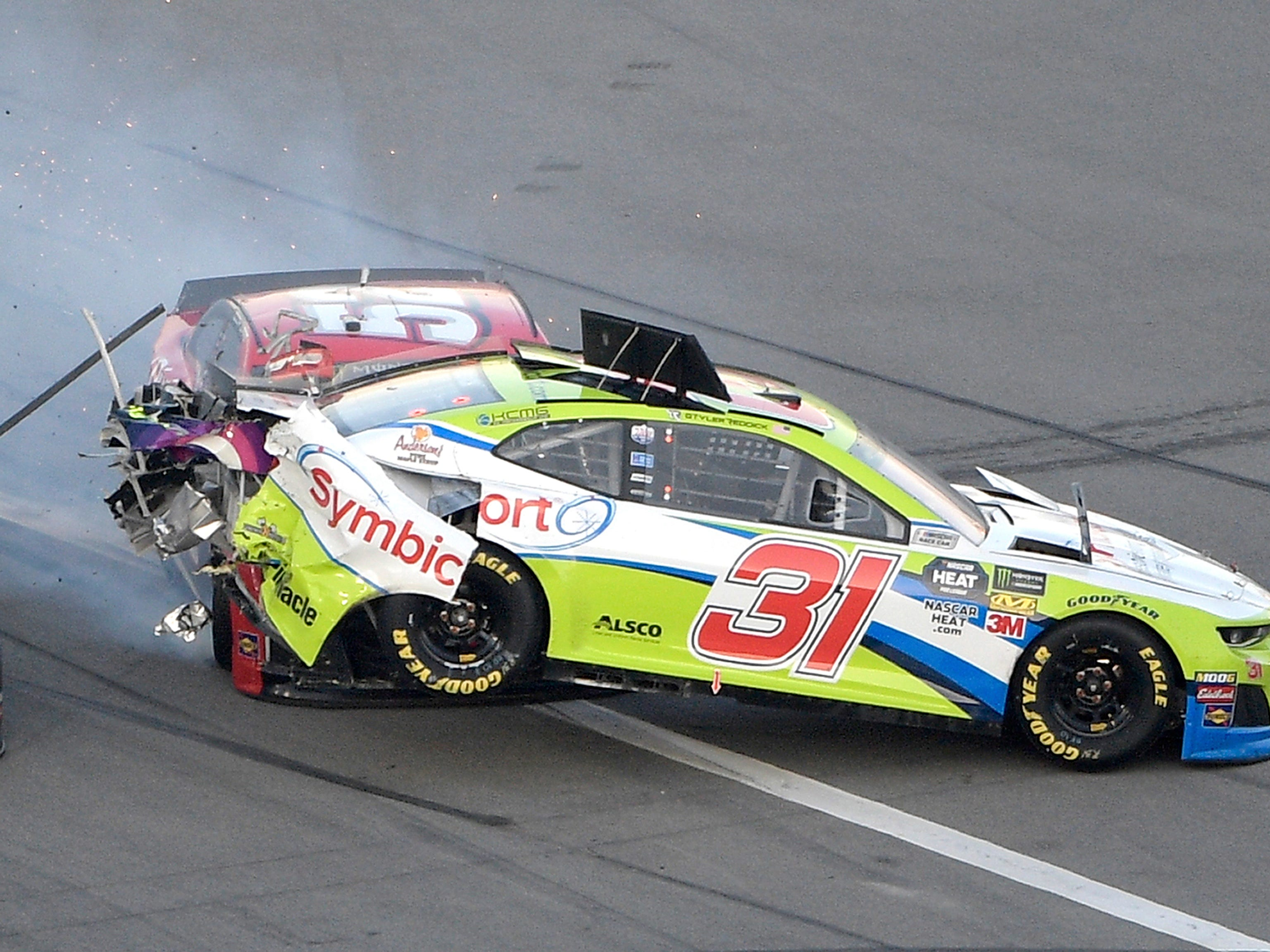 Tyler Reddick (31) is hit from behind by Cody Ware (52) during a NASCAR Daytona 500 auto race at Daytona International Speedway.