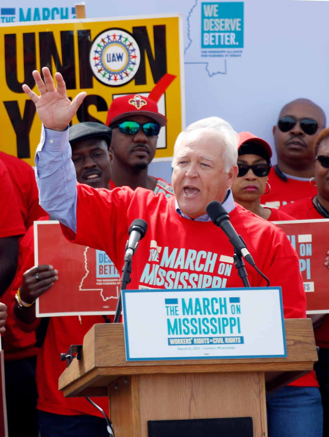 UAW president Dennis Williams calls for auto workers to demand their rights during a speech before thousands gathered at a pro-union rally near Nissan Motor Co.'s Canton, Miss., plant, Saturday, March 4, 2017. Participants marched to the plant to deliver a letter to the company demanding the right to vote on union representation to address better wages, safe working conditions and job security. (AP Photo/Rogelio V. Solis)