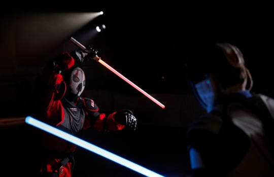 Julien Esprit, left, competes with Jean Baptiste Marchetti-Waternaux during a national lightsaber tournament in Beaumont-sur-Oise.