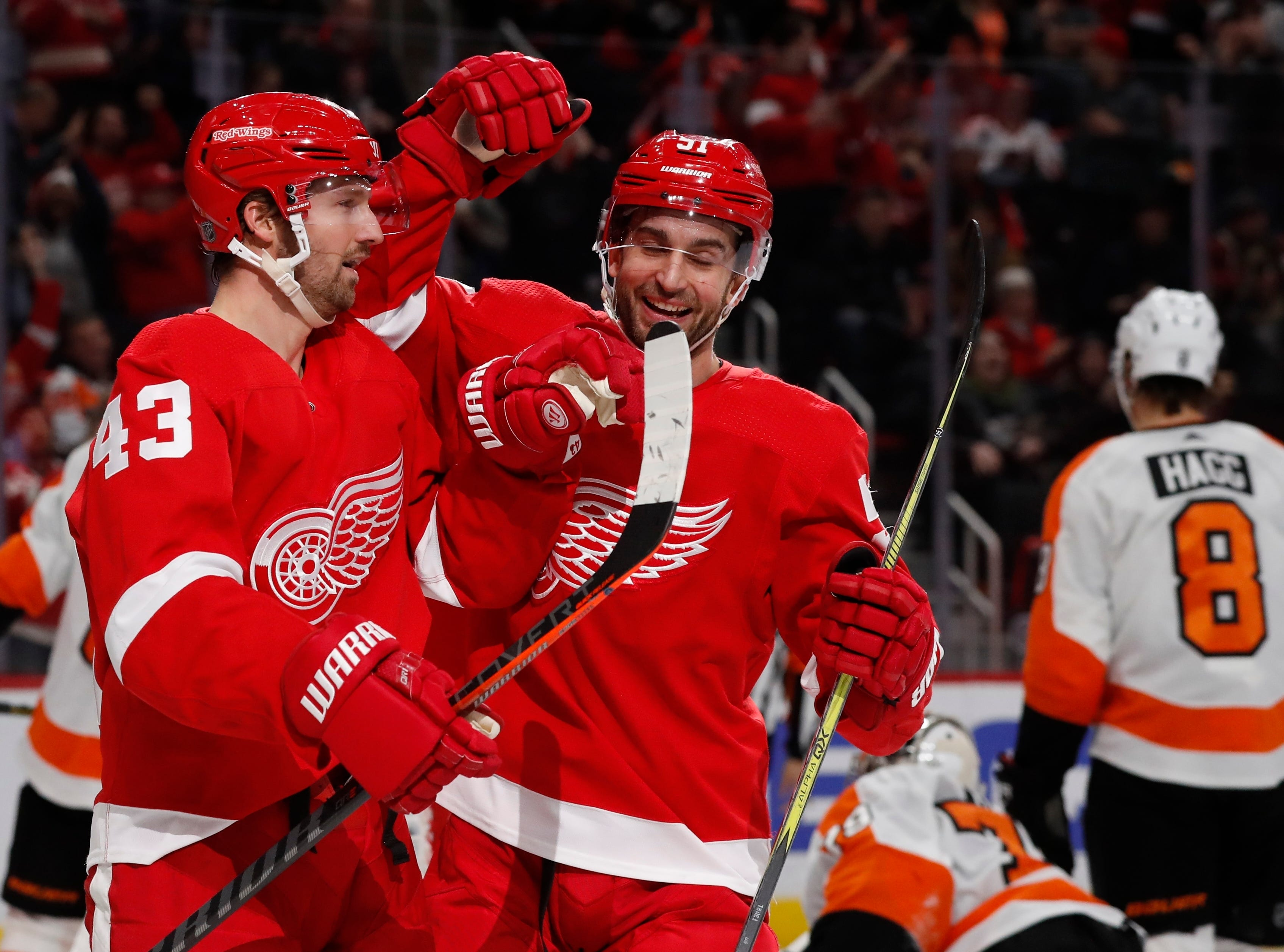 Detroit Red Wings left wing Darren Helm (43) is congratulated on his goal by teammate center Frans Nielsen (51) during the second period.