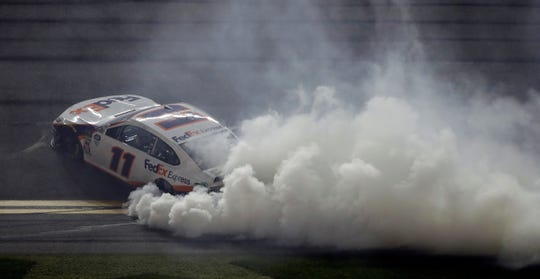 Denny Hamlin burns his tires after winning the Daytona 500.