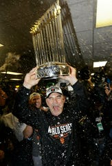 Giants manager Bruce Bochy celebrates after Game 7 of the World Series against the Royals in 2014, one of three titles he won in San Francisco.
