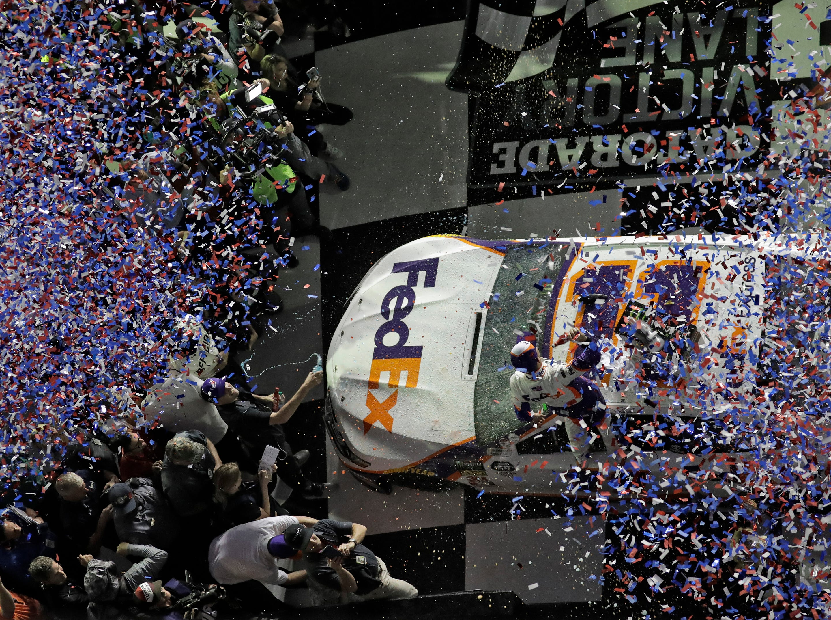 Denny Hamlin is showered with confetti in Victory Lane after winning a NASCAR Daytona 500 auto race Sunday, Feb. 17, 2019.