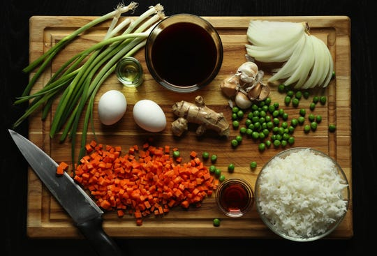 Cooks can switch up the flavors of their fried rice by combining the flavor profiles suggested below with the general cooking principles outlined in the basic recipe above. (Abel Uribe/Chicago Tribune/TNS)