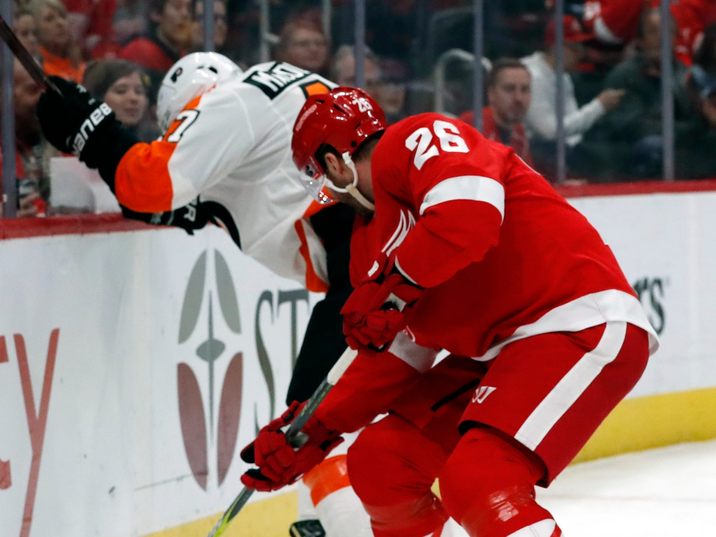 Philadelphia Flyers defenseman Andrew MacDonald (47) and Detroit Red Wings left wing Thomas Vanek (26) fight for the puck during the second period.