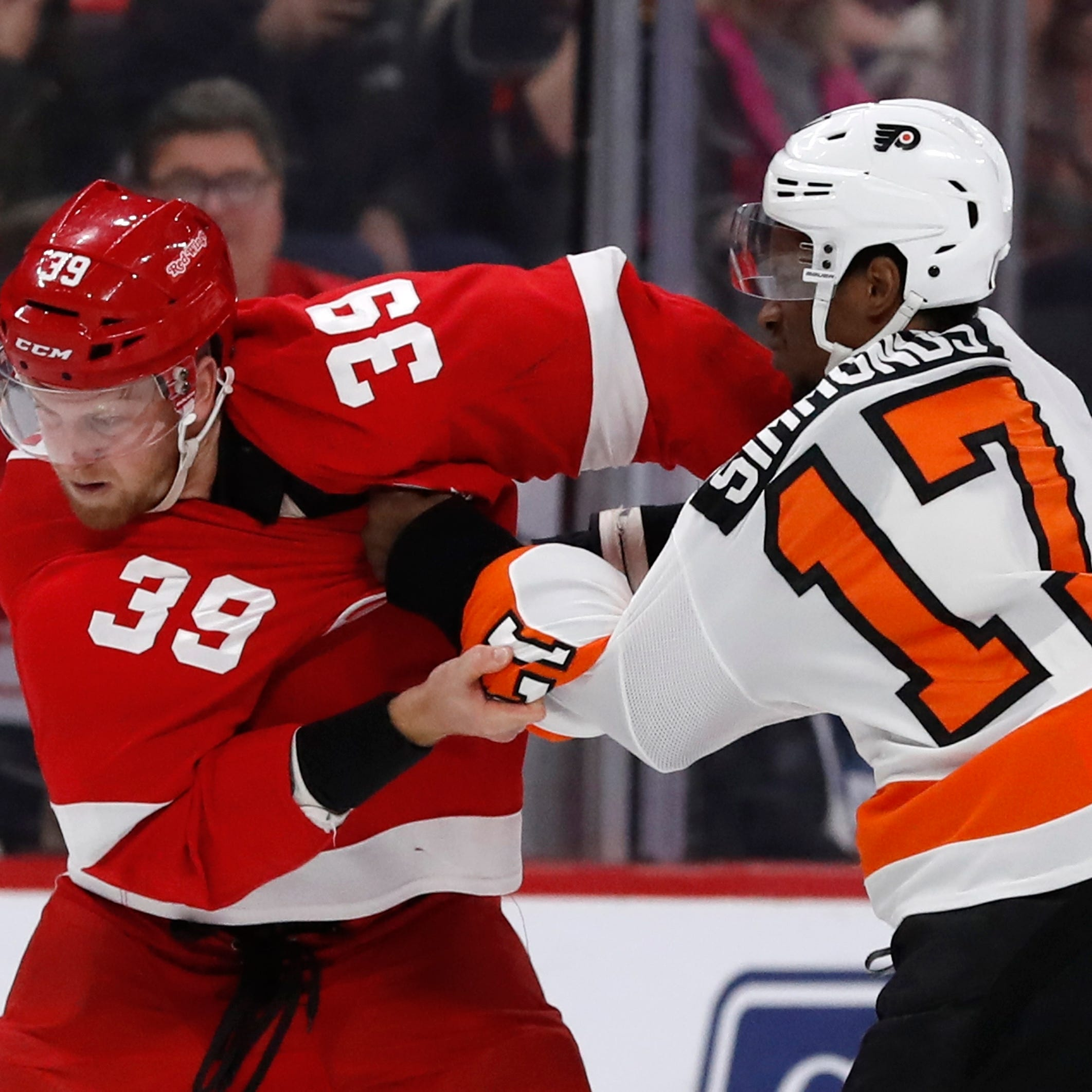 Red Wings' Anthony Mantha answers bell against Flyers, with fists and stick