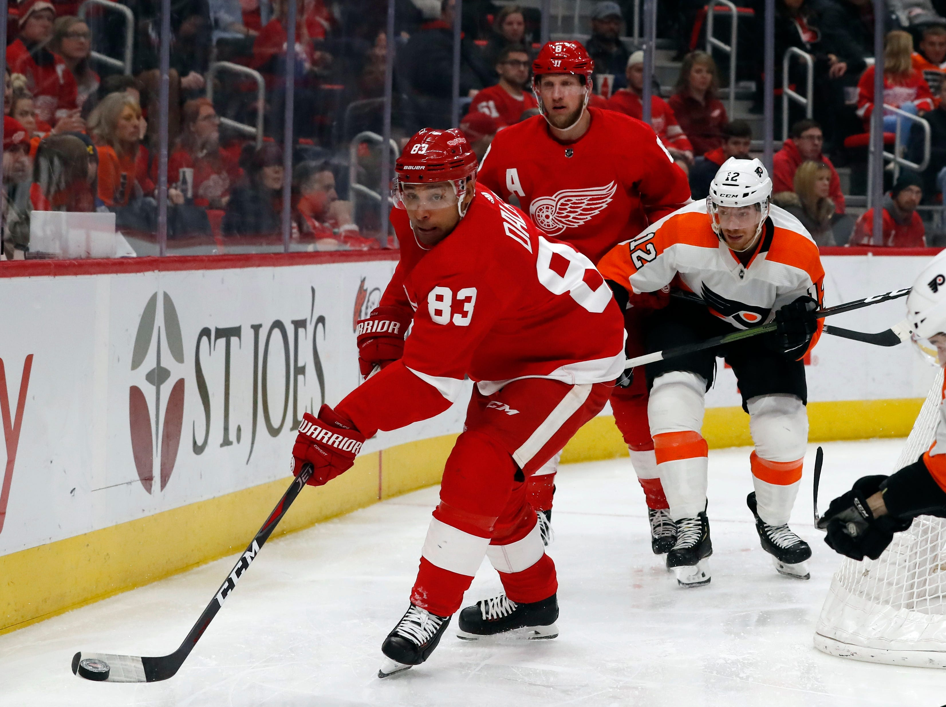 Detroit Red Wings defenseman Trevor Daley (83) controls the puck during the third period.