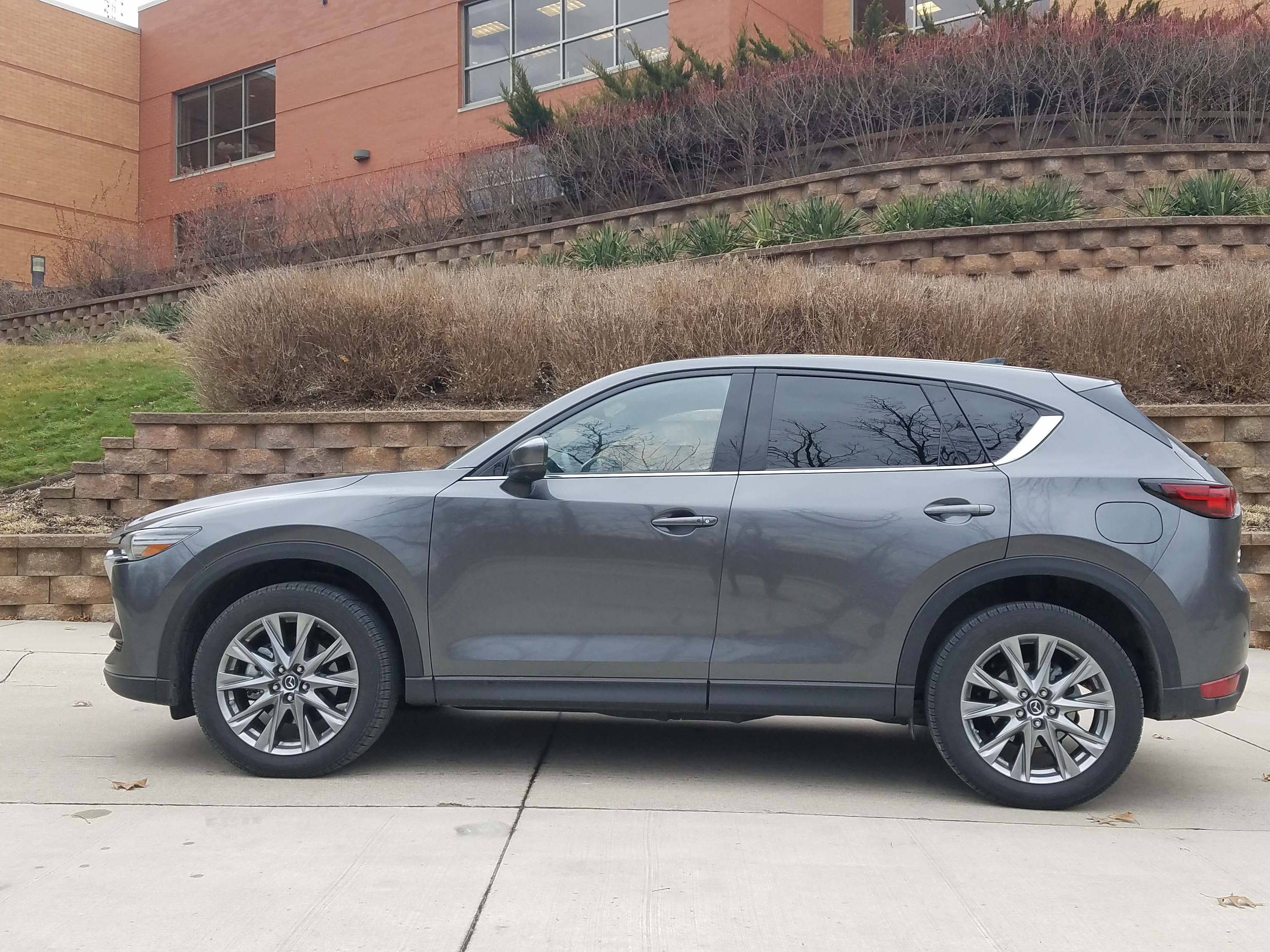 With narrow greenhouse and raked lines, the Mazda CX-5 Signature gives off a sporty vibe.