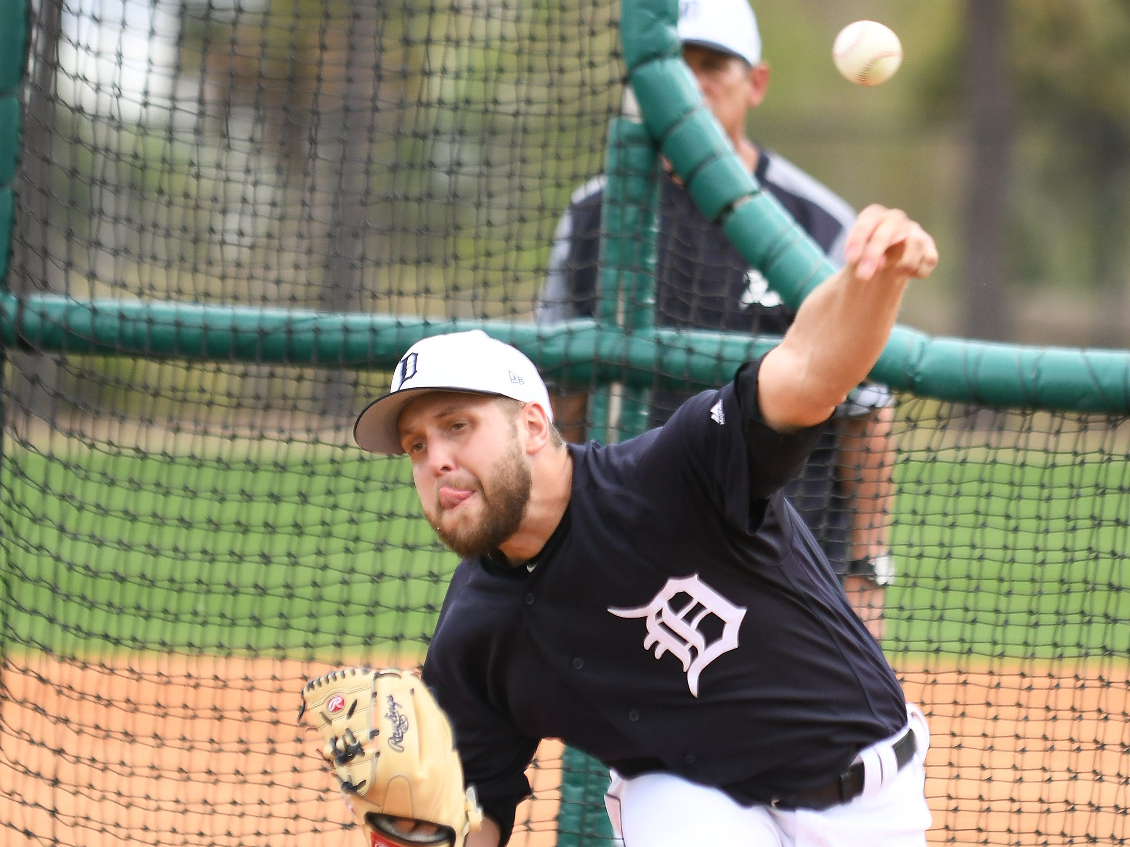 Tigers pitcher Matt Hall throws live batting practice.