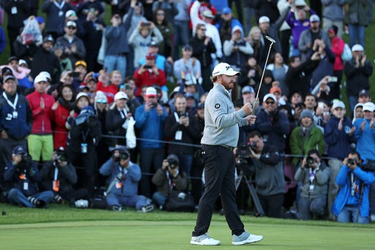 J.B. Holmes reacts after winning the Genesis Open at Riviera Country Club.