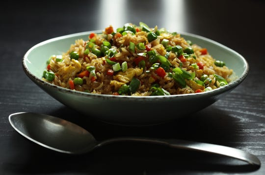 Leftover Chinese food from a Christmas feast inspired James P. DeWan to teach readers how to make crave-worthy fried rice. (Abel Uribe/Chicago Tribune/TNS)