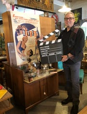 Steve Humphreys stands in his store Vogue Vintage on Hilton in Ferndale. He'll be watching the Oscars with interest on Sunday since he supplied some of the set decor.
