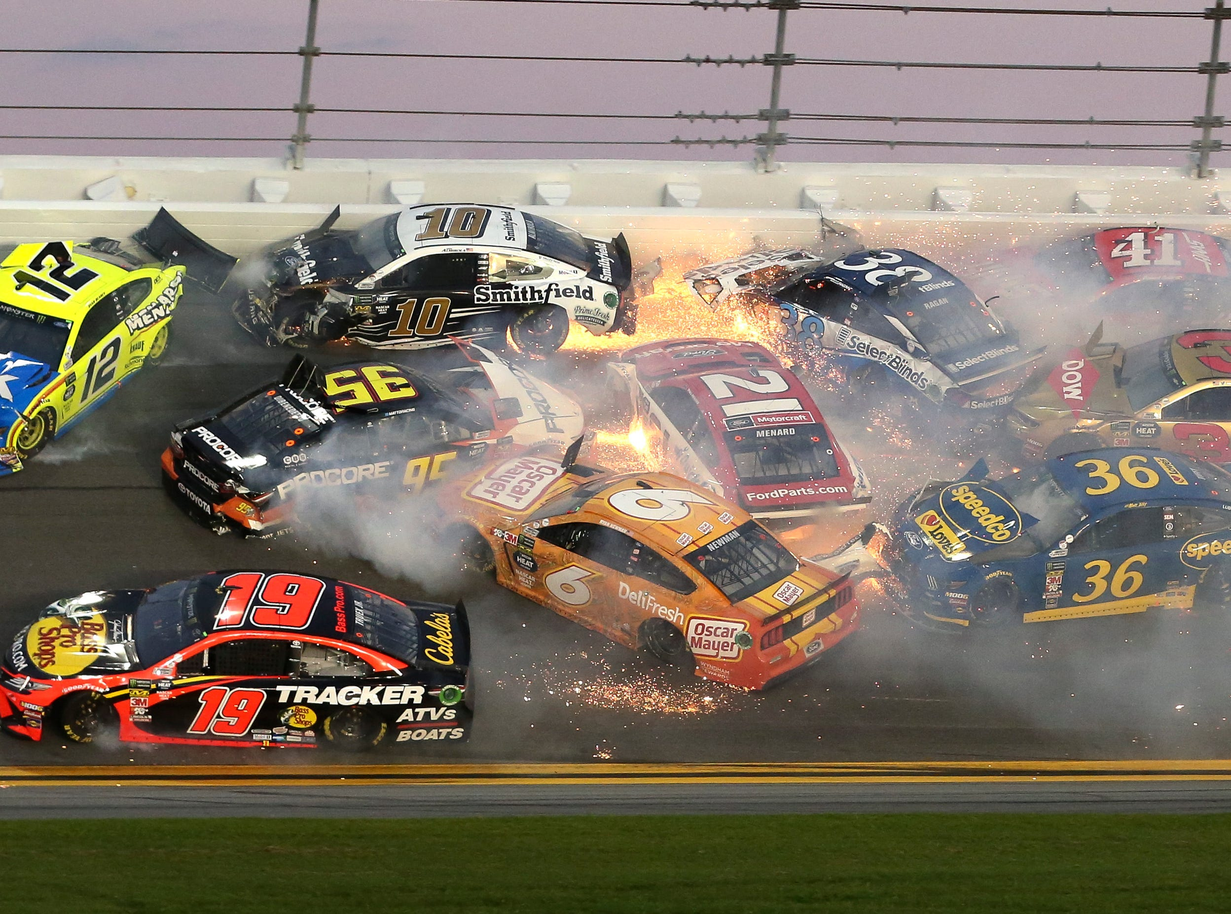 Multiple cars crash in turn 3 during the NASCAR Daytona 500 auto race at Daytona International Speedway.