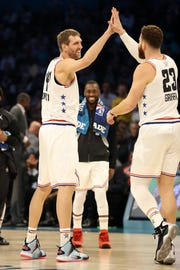 Dirk Nowitzki of the Dallas Mavericks and Team Giannis reacts with Blake Griffin of the Pistons against Team LeBron in the second quarter.
