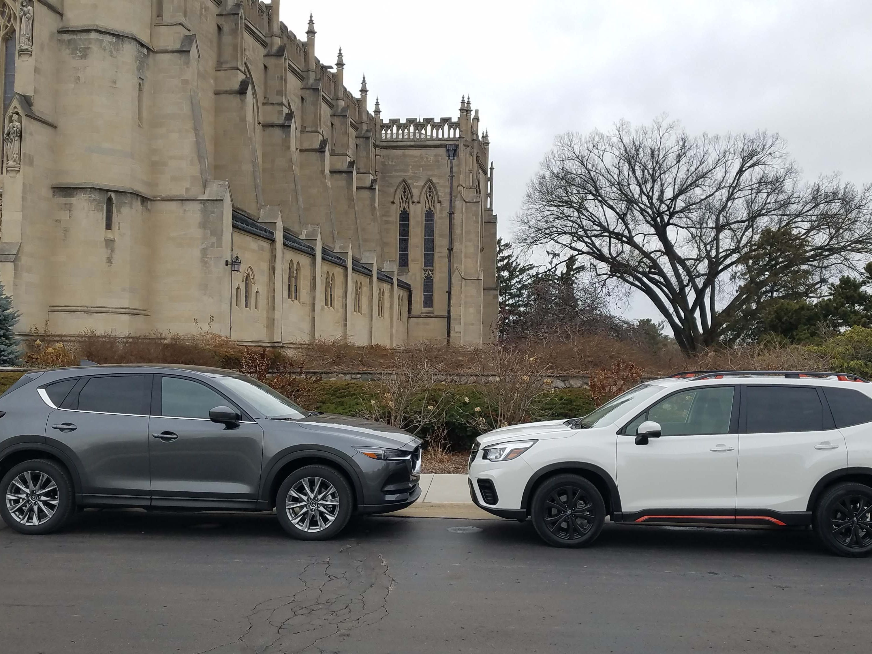 Profiles tell the tale. The Mazda CX-5 Signature, left, is sleek and sporty. The blockier Subaru Forester Sport is more concerned with cargo room and visibility.