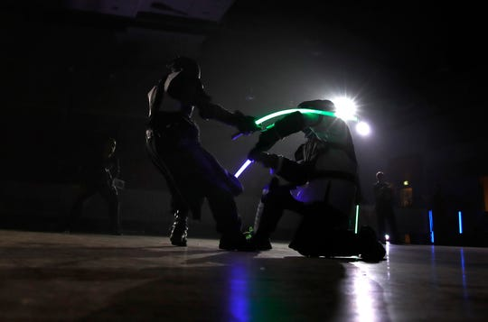 Competitors battle during a national lightsaber tournament in Beaumont-sur-Oise, north of Paris.