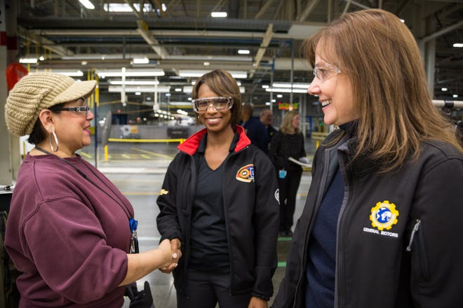 General Motors Executive Vice President Global Manufacturing Alicia Boler Davis, center, and GM Chairman and CEO Mary Barra, right, talk with employees Monday on a tour of GM Lansing Delta Township Assembly in Lansing. Barra announced  GM is investing $36 million at the plant for future crossover production.