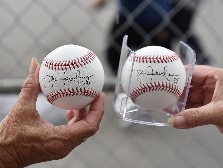 Floy Rondo of Caro an Kathy Chapelo of Houghton Lake show off their Niko Goodrum signed balls.