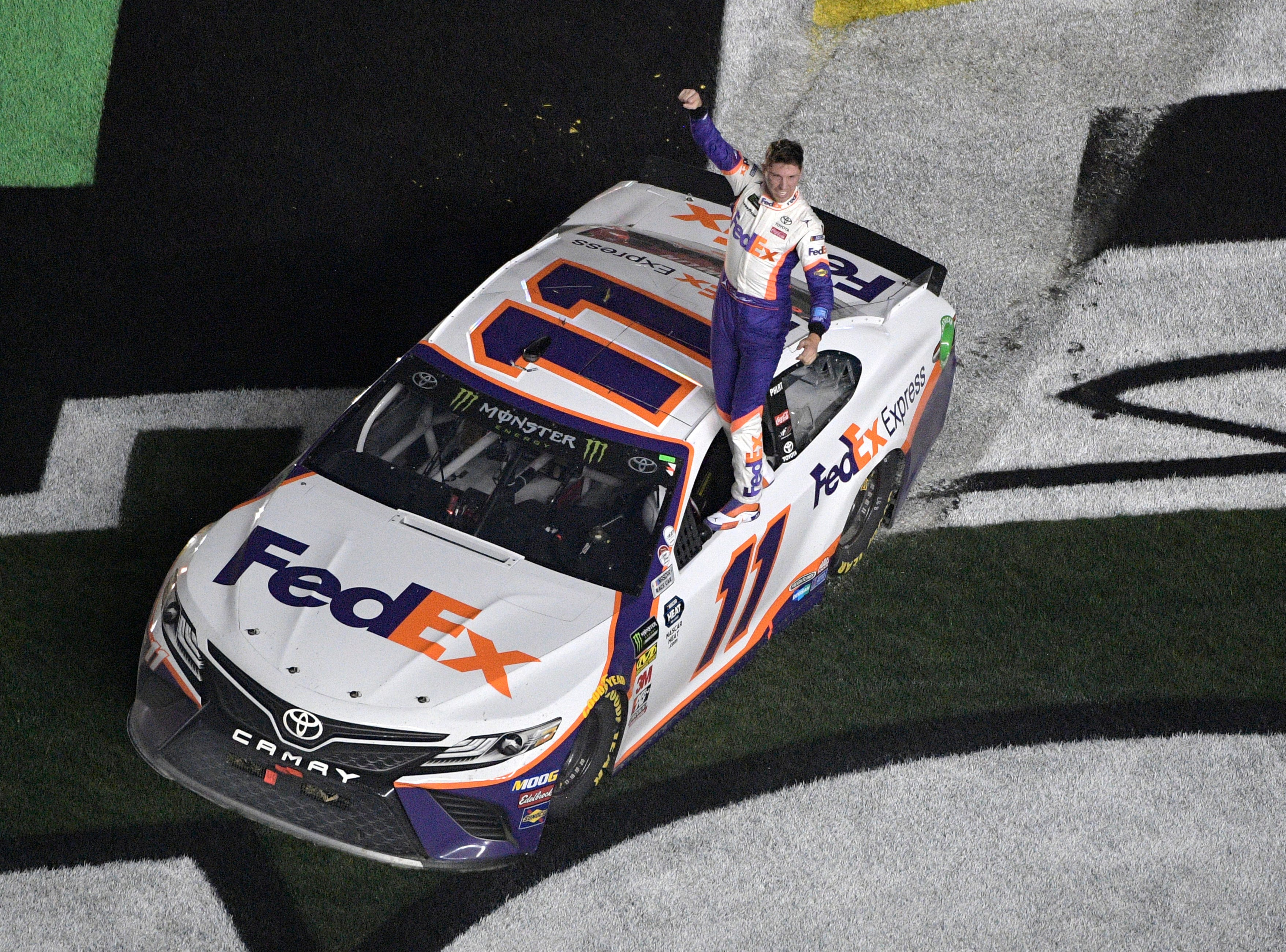 Denny Hamlin (11) celebrates after winning a NASCAR Daytona 500 auto race at Daytona International Speedway.