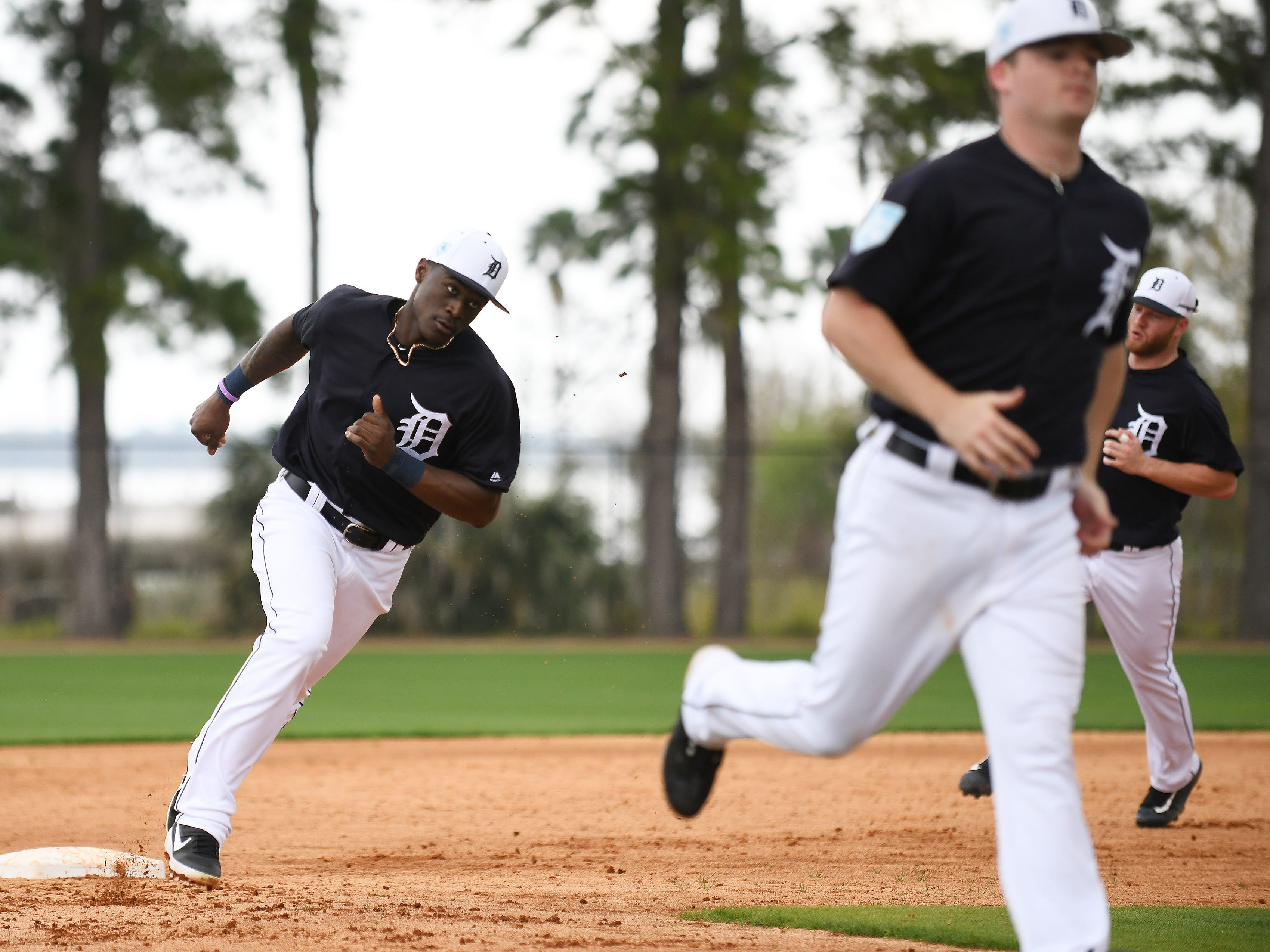Tigers prospect and non-roster invitee Daz Cameron, left, runs base running drills.