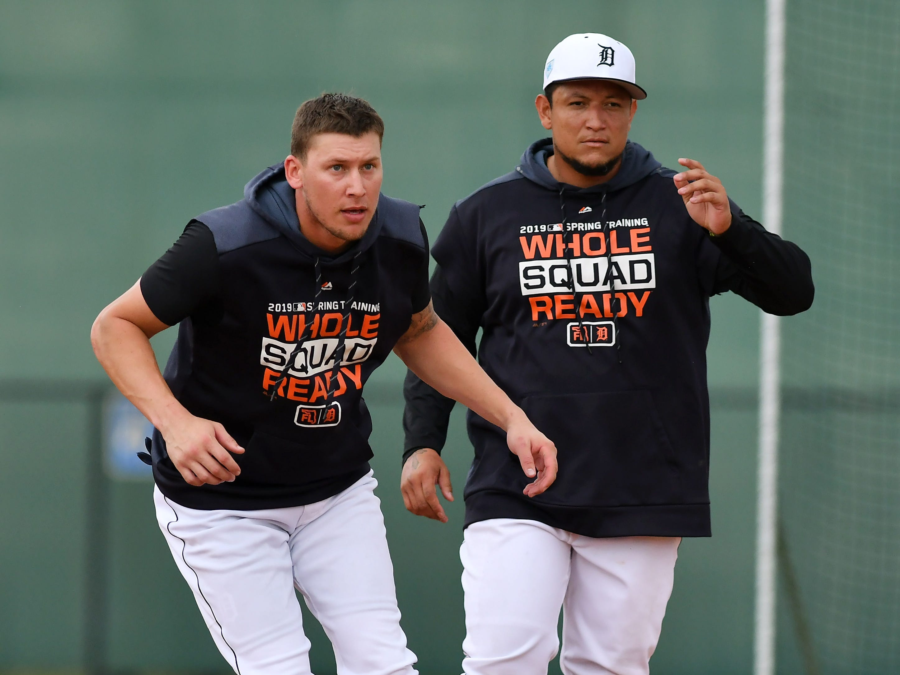 Tigers' JaCoby Jones, left, starts a base running drill next to Miguel Cabrera.