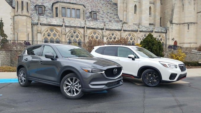 The Mazda CX-5 Signature (left) and Subaru Forester Sport are bookends of the $30K-$40K SUV segment. At $39K, the Mazda rivals SUVs costing $20K more for power and luxury. At $31K, the Subaru is an AWD bargain.