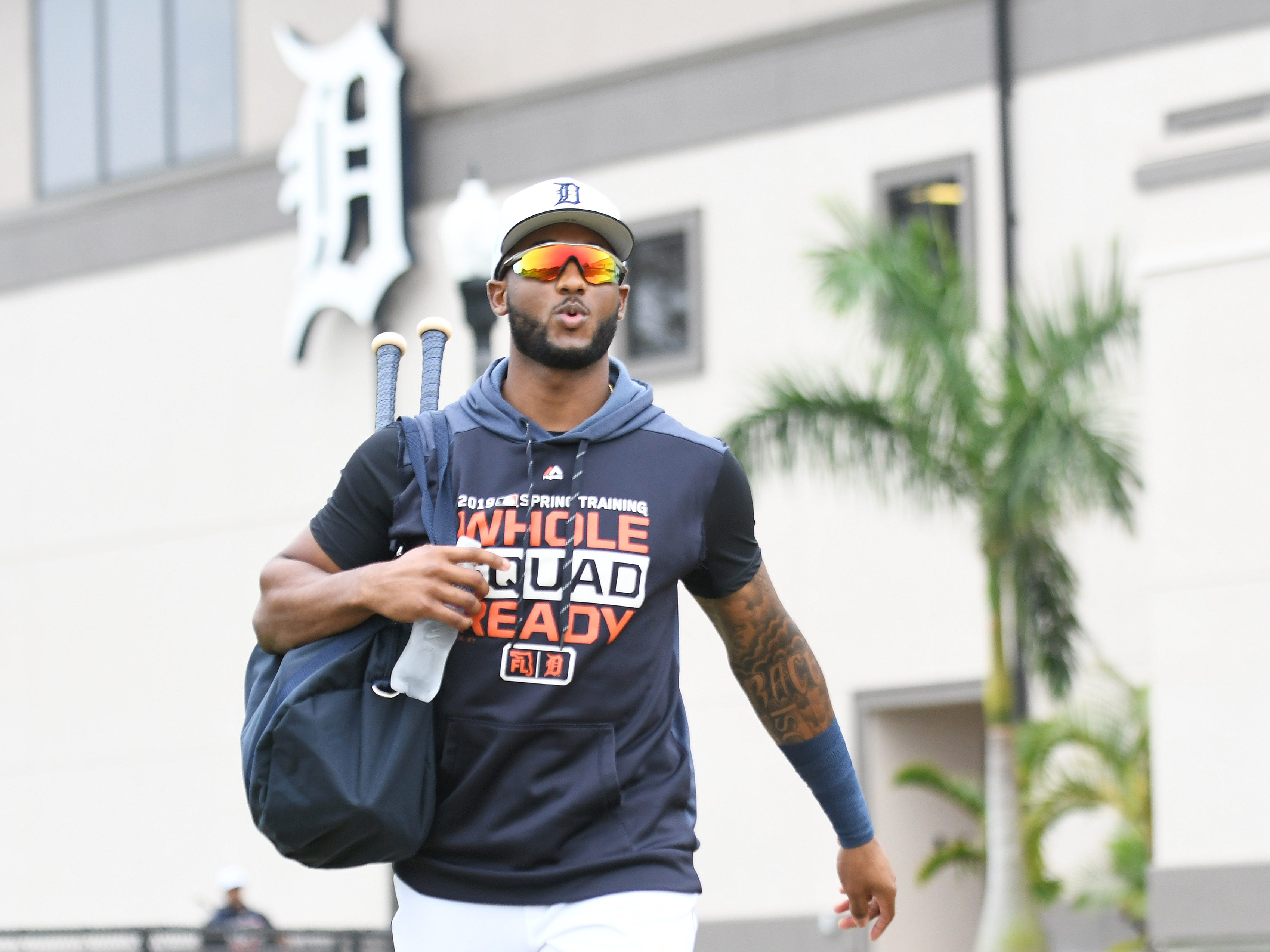 Tigers' Niko Goodrum heads towards the fields for the first full squad workout at Tigers spring training in Lakeland, Fla. on Feb. 18, 2019.