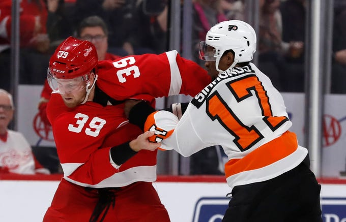 Detroit Red Wings right wing Anthony Mantha (39) and Philadelphia Flyers right wing Wayne Simmonds (17) fight during the first period of an NHL hockey game, Sunday, Feb. 17, 2019, in Detroit.