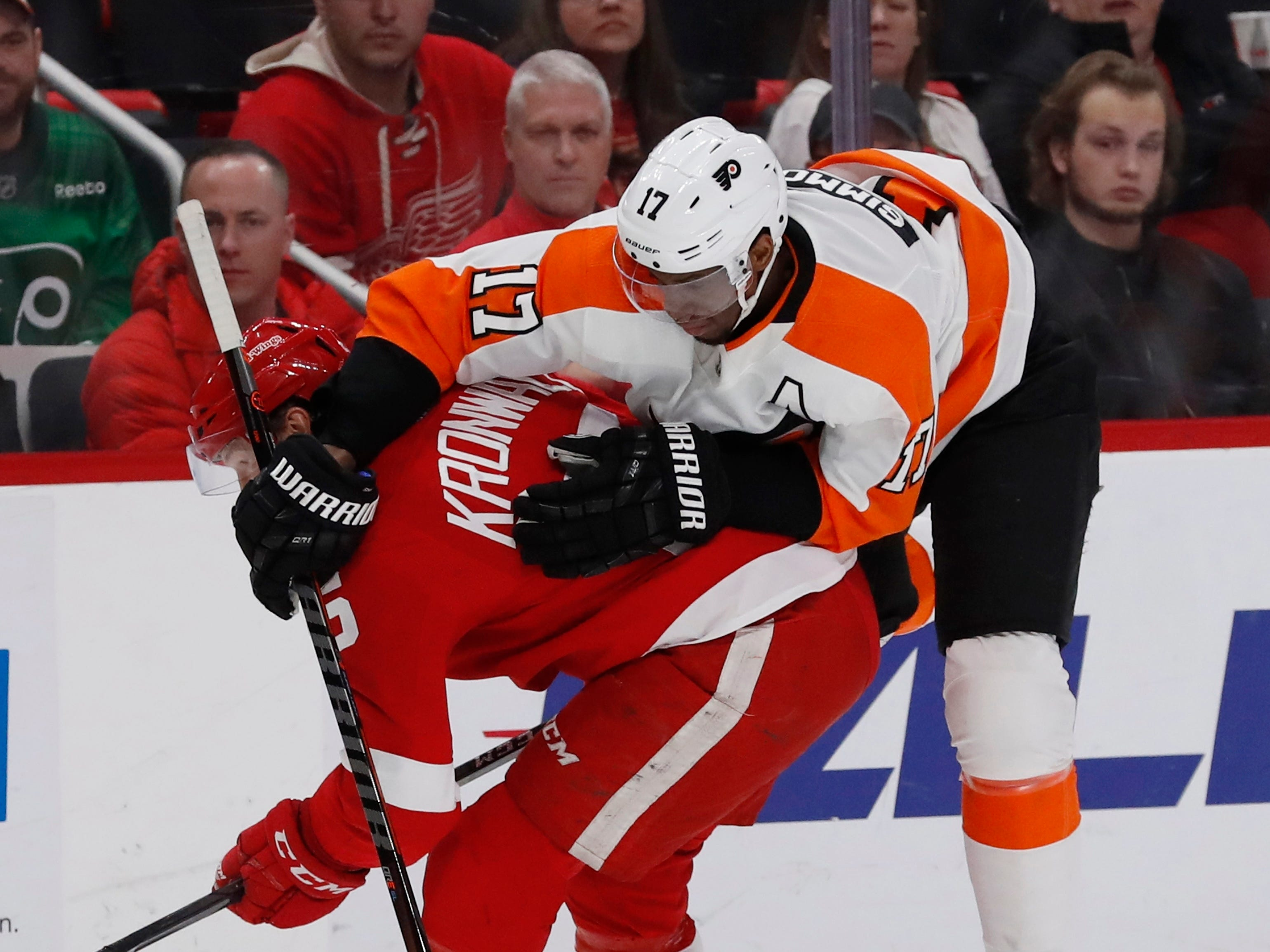 Philadelphia Flyers right wing Wayne Simmonds (17) runs into Detroit Red Wings defenseman Niklas Kronwall (55) during the first period.